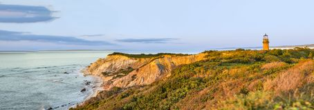 Gay Head Lighthouse and Gay Head cliffs of clay at the westernmo. St point of Martha`s Vineyard in Aquinnah, Massachusetts, USA. This historic lighthouse was Stock Photography