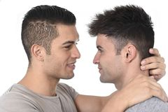 Gay homosexual couple young attractive handsome men in love kissing Stock Photography