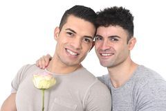 Gay homosexual couple young strong men in love on valentines with rose Royalty Free Stock Photo