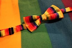 Lgbt pride bow on a multicolor background. Gay lesbian LGBT rights homosexual pride flag bow tie with rainbow mutlicolor design royalty free stock photography