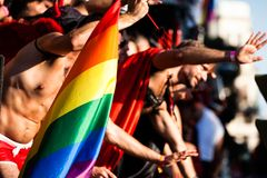 Gay and lesbians walk in the Gay Pride Parade Stock Images