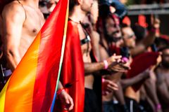 Gay and lesbians walk in the Gay Pride Parade Stock Photo