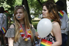 Gay and lesbians walk in the Gay Pride Parade. BUCHAREST, ROMANIA - JUNE 25: Unidentified participants taking part to the twelve gay pride parade through the Royalty Free Stock Photos