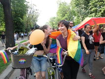 Gay and lesbians walk in the Gay Pride Parade. BUCHAREST, ROMANIA - JUNE 25: Unidentified participants taking part to the twelve gay pride parade through the Stock Images