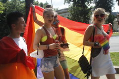 Gay and lesbians walk in the Gay Pride Parade. BUCHAREST, ROMANIA - JUNE 25: Unidentified participants taking part to the twelve gay pride parade through the Stock Photography