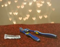 Gay LGBT couple blue toothbrush visual metaphor royalty free stock images