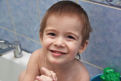 Gay little boy swimming in the bathtub. And plays Stock Photo