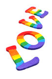Gay love. Letters painted as the gay pride flag forming the word love on a white background royalty free stock photography
