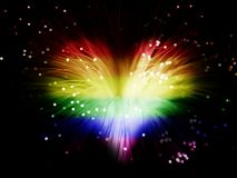 Gay love. Rainbow colored abstract heart made from fibers  lights  in darkness ( love concept Royalty Free Stock Photos