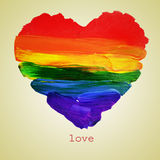 Gay love. The word love and a rainbow heart painted on a beige background, with a retro effect Royalty Free Stock Photography