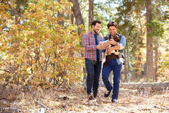 Gay Male Couple With Baby Walking Through Fall Woodland stock image