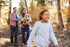 Gay Male Couple With Children Walking Through Fall Woodland Royalty Free Stock Photos