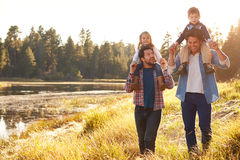 Gay Male Couple With Children Walking By Lake Stock Photos