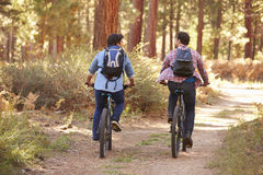 Gay Male Couple Cycling Through Fall Woodland Stock Photos
