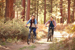 Gay Male Couple Cycling Through Fall Woodland Royalty Free Stock Photo