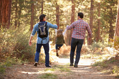 Gay Male Couple With Daughter Walking Through Fall Woodland Royalty Free Stock Photos