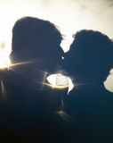 Gay Male Couple Romantic Kiss in Silhouette stock image