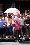 Gay man with pink umbrella Stock Photos