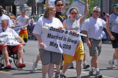 Gay Marriage Legal in Iowa. MINNEAPOLIS - JUNE 28:  Legally Married Gay Couple from Iowa March in the Minneapolis Gay Pride Parade on June 28, 2009 Royalty Free Stock Photography