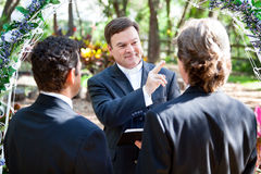 Gay Marriage - Ministers Blessing. Minister blessing a gay couple while performing their wedding ceremony stock image