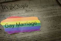 Gay Marriage rainbow news headline. Gay Marriage rainbow flag news headline on US Constitution Stock Image