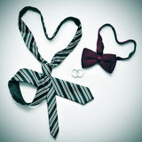 Gay marriage. A tie and a bow tie forming hearts and wedding rings, depicting the gay marriage concept, with a retro effect Royalty Free Stock Images