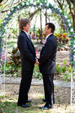 Gay Marriage - Under the Floral Arch Stock Photo