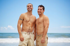 Gay men at the beach stock images