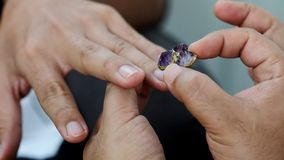 Gay men wear ring in engagement event. Love valentines, borderless love for long term relationship stock image