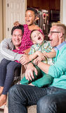 Gay Parents Tickling Their Children Stock Images