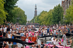 Gay Pride 2008. AMSTERDAM - AUGUST 2: A large crowd gather at the Amsterdam canals to watch 'Gay Pride 2008', an event held on august 2th, 2008, in Amsterdam Stock Images