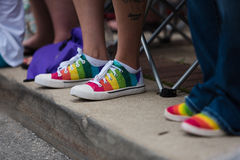Gay Pride Festival - Shoes in the parade. Rainbow sneakers are seen at the Des Moines pride parade today Stock Photos