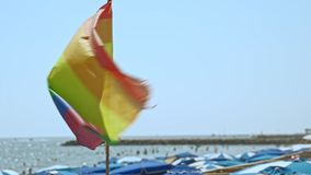 Gay pride flag blowing in the wind on Sitges Beach, Spain. Gay pride flag blowing in the wind on Sitges, in Barcelona province. Perhaps Spain top gay stock video