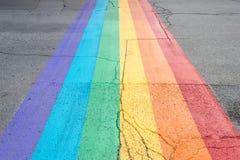 Gay pride flag crosswalk. In Montreal gay village royalty free stock images