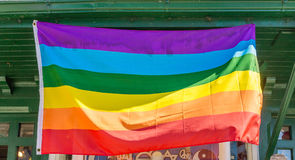 Gay Pride Flag in Storefront. A Gay Pride Flag flying in Storefront royalty free stock images