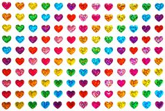 Gay pride, homosexual, Valentine`s day and lgbt concept - hearts in colors of the flag of sexual minorities background as card for stock image