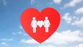 Female couple white paper pictogram on red heart. Gay pride, homosexual, valentines day and lgbt concept - female couple white paper pictogram on red heart over stock photo