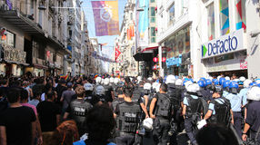 Gay Pride Istanbul. ISTANBUL, TURKEY - JUNE 28, 2015: LGBT Pride Istanbul was banned by the Istanbul Municipality, so police intervene in with tear gas and water Royalty Free Stock Photo