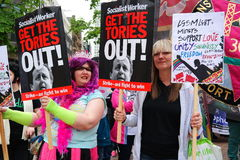 Gay Pride March and Rally on 23rd May 2015. Two women with Socialist Worker banners at Gay Pride Rally in Birmingham England Stock Photography