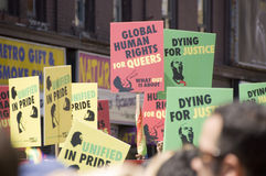 Gay Pride Parade. The annual Gay Pride Parade in Toronto Canada, banners reading global human rights for queers, dying for justice and unified in pride royalty free stock photo