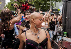Gay pride parade in Berlin. BERLIN, GERMANY - JUNE 21, 2014:Christopher Street Day.Crowd of people participate in the parade celebrates gays, lesbians, bisexuals Stock Photography