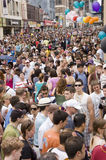 Gay Pride Parade Crowd. The annual Gay Pride Parade in Toronto Canada with thousands as spectators on Yonge Street royalty free stock image