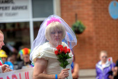 Gay pride parade in Manchester, UK 2011. Man in a bride's dress and veil in Manchester at Gay Pride 2011. Manchester, England - 27.08.11 Royalty Free Stock Image