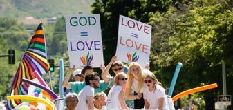 Gay Pride Parade in Salt Lake City, Utah. Salt Lake City, Utah, USA - June 7, 2015. Marchers carry signs in the Salt Lake City, Utah Gay Pride Parade Stock Photos