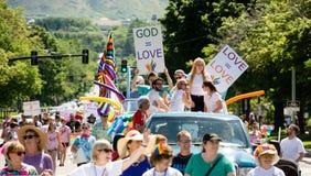 Gay Pride Parade in Salt Lake City, Utah. Salt Lake City, Utah, USA - June 7, 2015. Marchers carry signs in the Salt Lake City, Utah Gay Pride Parade Stock Photo