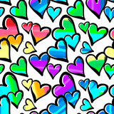 Gay pride rainbow colored hearts seamless pattern. Hand rawn ink brush strokes design in doodle grunge style.Modern painted artistic print for a logo, cards Royalty Free Stock Images