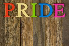 Gay pride. Rainbow Gay Pride sign on a wood background royalty free stock photo