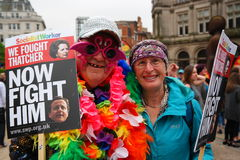 Gay Pride Rally and March 23 May 2015. Costumed couple at Gay rights rally Socialist Worker banner feather boa man and woman Stock Images