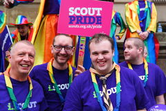 Gay Pride rally on 23rd May 2015. Group of men from Scouting movement at Gay Pride march and rally in Birmingham England with banner bright smiling Royalty Free Stock Photography