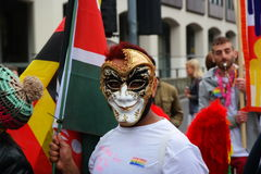 Gay Pride rally on 23rd May 2015. Man in mask at Gay Pride march and rally in Birmingham England colourful flags Royalty Free Stock Photography